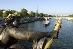 Seine and Eiffel Tower. Statue foreground, river Seine and barge, Eiffel Tower in background Stock Image