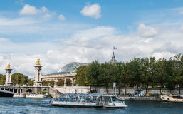 Seine ferry passes in front of Grand Palais, Paris Royalty Free Stock Image