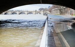 Seine is out of its banks under Parisian bridge Royalty Free Stock Photos