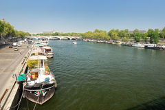 The Seine in Paris. With boats, bridges Royalty Free Stock Images