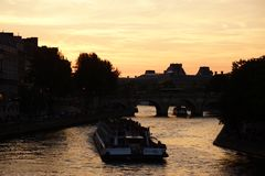 The Seine in Paris - France. The Seine in Paris is a part of the landscape of the capital of France. The Seine cuts Paris in its environment middle even if the Stock Image
