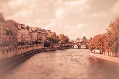 Seine Paris Tilt-shift. Tilt-shift miniature view of the River Seine from Paris with vintage filter effect Royalty Free Stock Photos