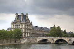 Seine quay and The Louvre Museum. Paris, France Royalty Free Stock Photo