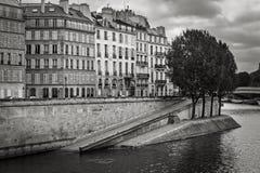 Seine River Bank on Ile Saint Louis, Paris, France. View of the Seine River bank and Paris buildings on Ile Saint Louis. Black & White view of Ile Saint-Louis Royalty Free Stock Photos