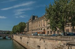 Seine River bank with walls and buildings under blue sky in Paris. Paris, France - July 08, 2017. Seine River bank with walls and buildings under blue sky in Royalty Free Stock Photography