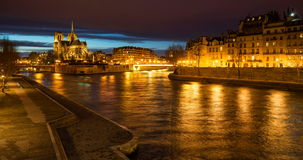The Seine River banks by the Ile Saint Louis with Notre Dame Cathedral at twilight. Paris. The Seine River banks by the Ile Saint Louis and Ile de la Cite with stock footage