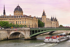 Seine River and Bateau Mouche in Paris, France Royalty Free Stock Photos