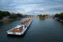Seine River Cruise Ship Paris H. Paris, France - July 9, 2011: A Seine river cruise ship carries tourists and approaches the Ile de la Cite.  Paris is the most Royalty Free Stock Photo