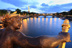Seine river and Eiffel Tower seen pont Alexandre III in Paris. France. Eiffel Tower is the French most visited monument and use 20,000 light bulbs in the show Royalty Free Stock Image