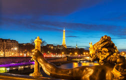 The Seine river and Eiffel Tower seen pont Alexandre III. Paris, France - March 04, 2017: Seine river and Eiffel Tower seen pont Alexandre III . Eiffel Tower is Royalty Free Stock Photo