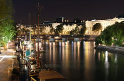 Seine river and Louvre illuminated Royalty Free Stock Photography
