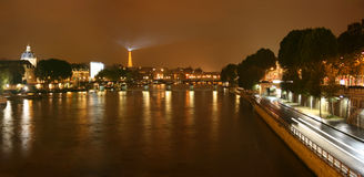 Seine river at night panorama. Panoramic view of Seine river at night from Pont Neuf, Paris, France Stock Photos