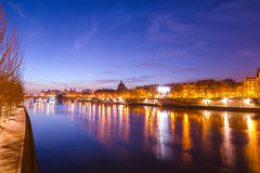 Seine river and Old Town of Paris in the sunrise Stock Image