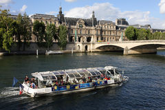 The Seine river in Paris. Bateaux Mouches are open excursion boats that provide visitors to Paris, France, with a view of the city from along the river Seine