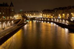 Seine river in Paris at night Royalty Free Stock Images