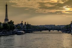 Seine River in Paris. At sunset and in the background the Eiffel Tower in France Stock Photos
