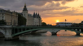 Seine river in Paris at sunset orange sun. Beautiful orange sunset over the waters of the Seine River crossing Paris city center stock footage