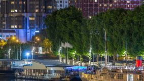 Seine river with ship in Paris at night timelapse, waterfront of the seine river in the city of Paris in france. View from Mirabeau bridge. Boat station and stock video