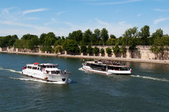 Seine river with tourists ship in Paris Stock Images