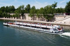 Seine river with tourists ship in Paris Royalty Free Stock Image