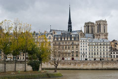 Seine riverbank, Paris. Seine riverbank and Notre Dame Cathedral, Paris Stock Photo