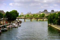 Seine riverbank with Paris landmarks, France Stock Images