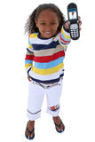 Seis años hermosos con el teléfono celular sobre blanco Foto de archivo libre de regalías