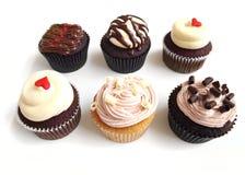 Seis assorted bolos do copo Fotografia de Stock Royalty Free