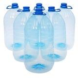 Seis botellas grandes de agua (trayectoria de recortes) Fotografía de archivo libre de regalías