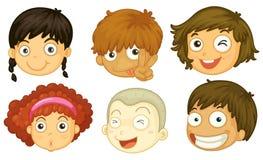 Seis cabeças de crianças diferentes Fotografia de Stock