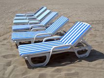 Seis cadeiras de praia Fotografia de Stock Royalty Free