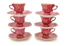 Seis copos com saucers Imagens de Stock Royalty Free
