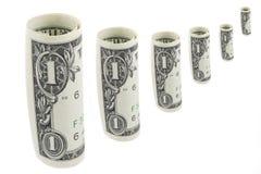 Seis de un billete de banco del dólar en los rollos en el fondo blanco Foto de archivo libre de regalías