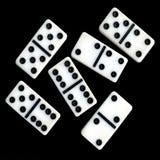 Seis dominós en un fondo negro Fotografía de archivo libre de regalías
