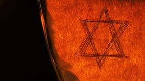 Seis estrelas do Hexagram da estrela do ponto de David Religion Symbol no Burning de papel velho video estoque