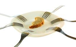 Seis forquilhas e uma crosta de um pão Imagem de Stock