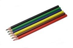 Seis lápices del color aislados en blanco Fotografía de archivo libre de regalías