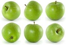 Seis manzanas verdes Imágenes de archivo libres de regalías