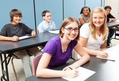 Seis miúdos da escola na classe Foto de Stock