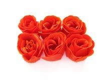 Seis pedazos de jabón color de rosa del rojo. Fotografía de archivo