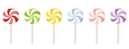 Seis pirulitos coloridos. Imagens de Stock