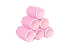 Seis rodillos rosados del velcro empilados en una pirámide Fotografía de archivo