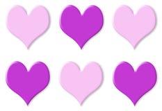 Seis roxos e corações cor-de-rosa Foto de Stock