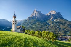 Seis am Schlern, Dolomites, South Tyrol, Italy. Panoramic view of idyllic mountain scenery in the Dolomites with St. Valentin Church and famous Mount Sciliar in royalty free stock image