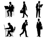 Seis siluetas de los hombres de negocios Foto de archivo