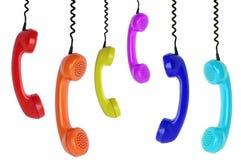 Seis suspensões coloridas dos telefones imagem de stock royalty free