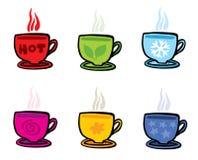 Seis tazas con diversos símbolos en blanco Fotos de archivo