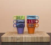 Seis tazas de café coloreadas Fotos de archivo libres de regalías