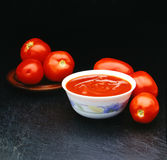 Seis tomates de los tomates para un souce Foto de archivo libre de regalías