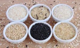 Seis variedades de arroz crudo Fotografía de archivo libre de regalías